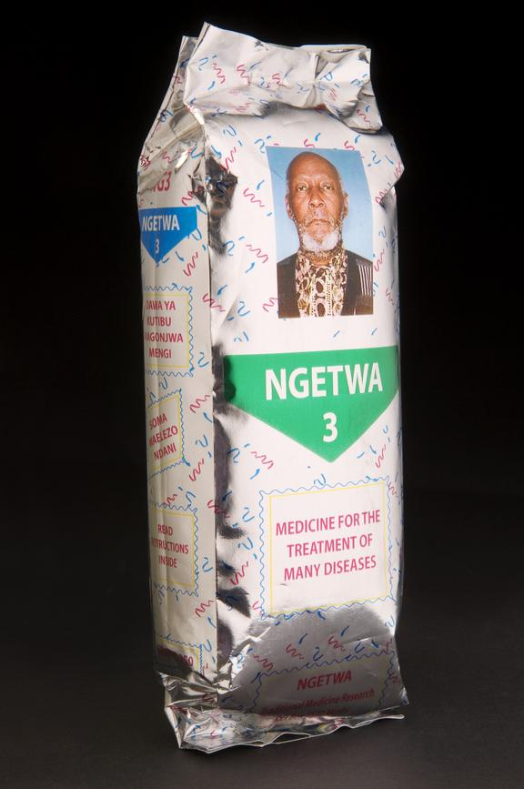Ngetwa- traditional East African remedy. Front three quarter view. Black background.