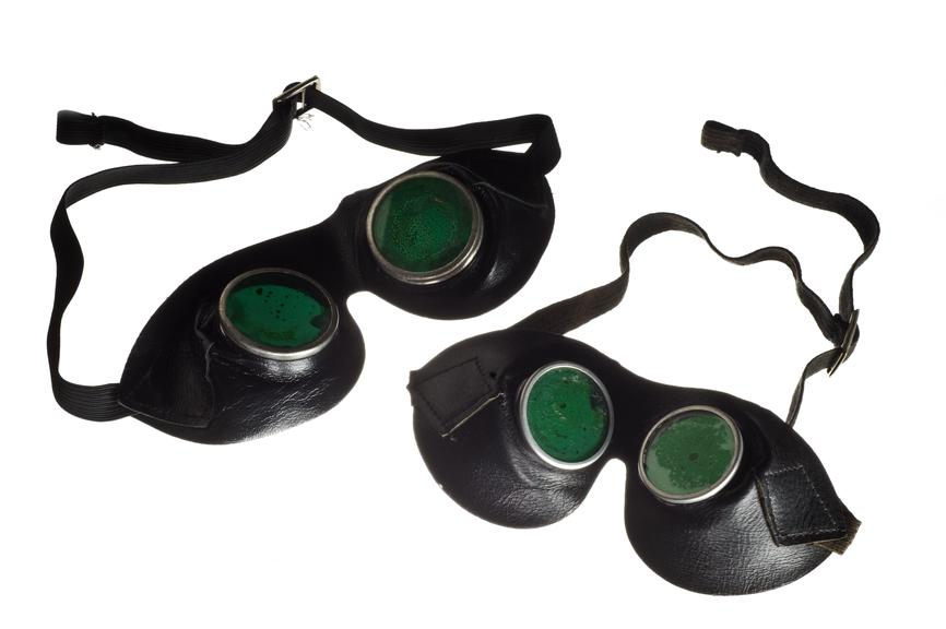 Two pairs of protective goggles, with green tinted lenses, for use during light therapy at the Lord Mayor Treloar