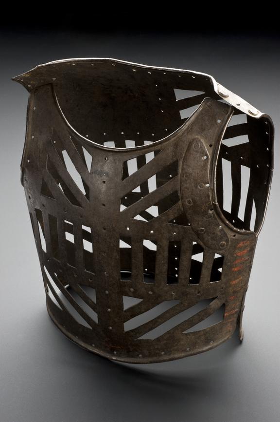 Iron orthopaedic corset for children. Full view, graduated matt black perspex background.