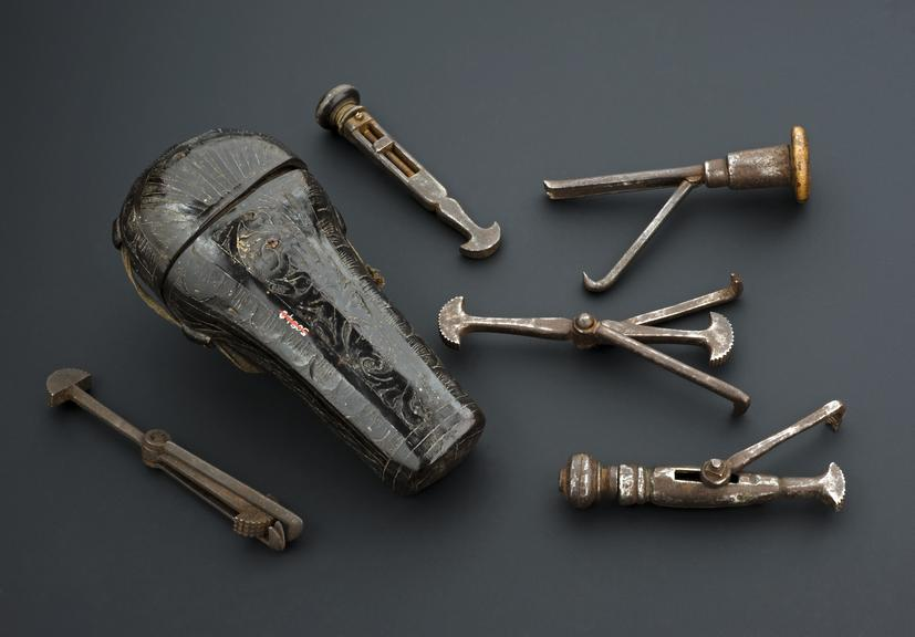 Dental instrument set comprising five pelicans in tooled leather case, 16th-17th centuries, French, Dr. Hamonic