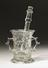 Glass mortar and pestle, possibly 17th century. Front view. Portrait format. Graduated grey background.