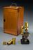 Mahogany case with two Zeiss objectives (labelled 'A' & 'D') for compound monocular microscope, signed by Baker of