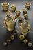 Lefthand side, A167830 - Set of 17th century brass weights for wool. Righthand side, A5942 - Set of 17th century nested
