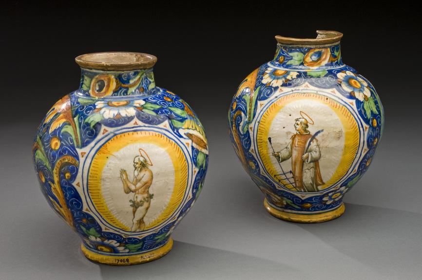 Left hand side - A42578, Tin glazed earthenware pharmacy jar, portrait of St. Lawrence, made in Venice, Italian 1501 -