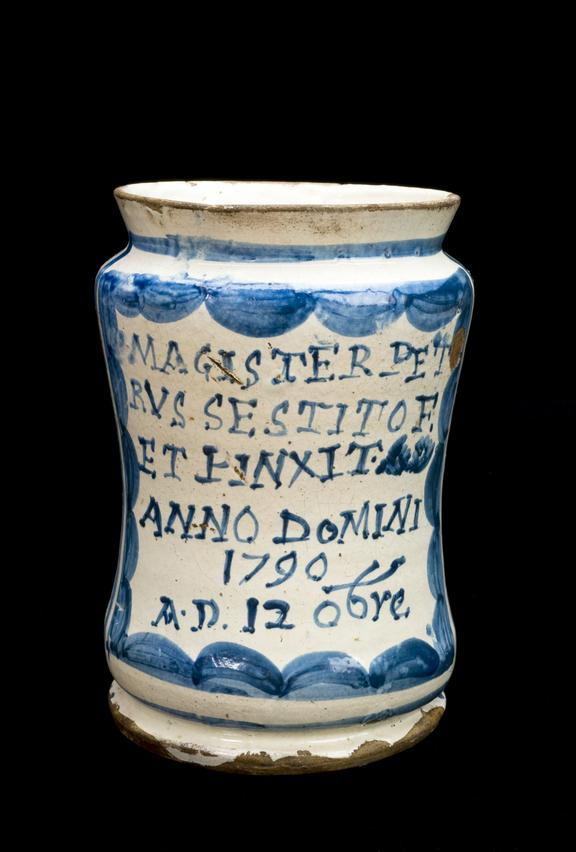 Albarell vase, Italian, 1790, perhaps from Castelli, signed and dated, blue and white maiolica. Black background.