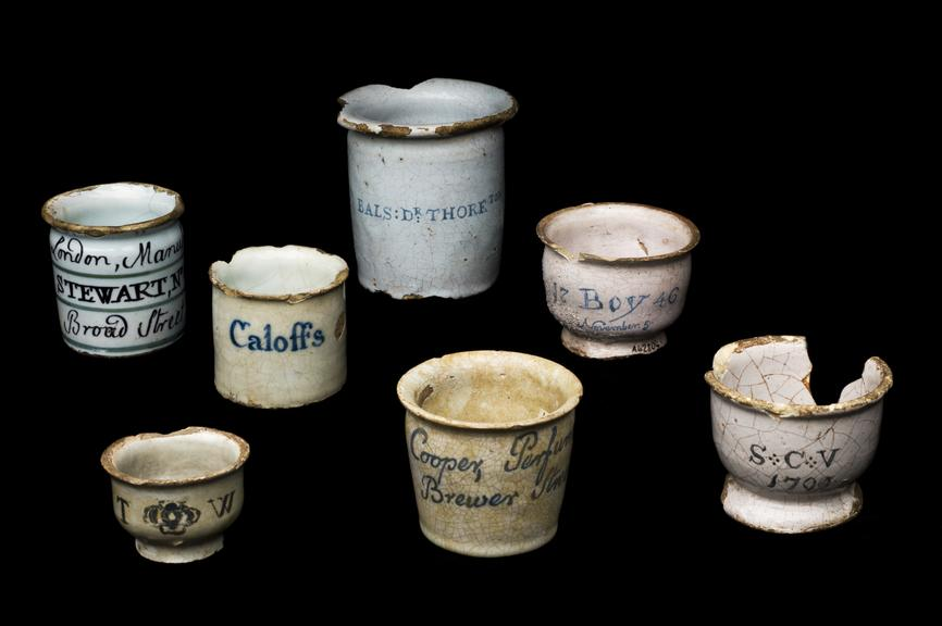 From left to right: Earthenware dispensing pot, tin glazed, London, about 1820 or earlier, Earthenware dispensing pot,