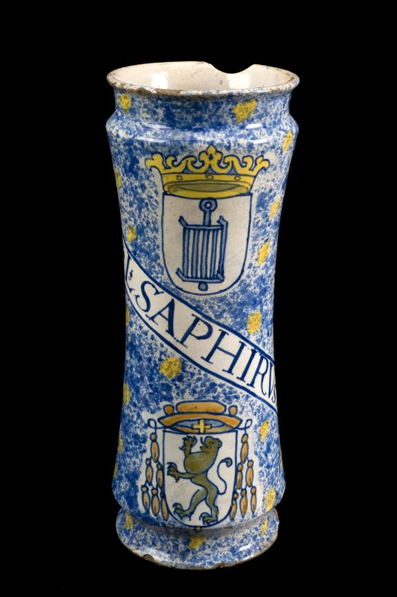 Albarello, earthwave, from monalstery of El Escorial, made at Talavera, 1600-1625. Black background.