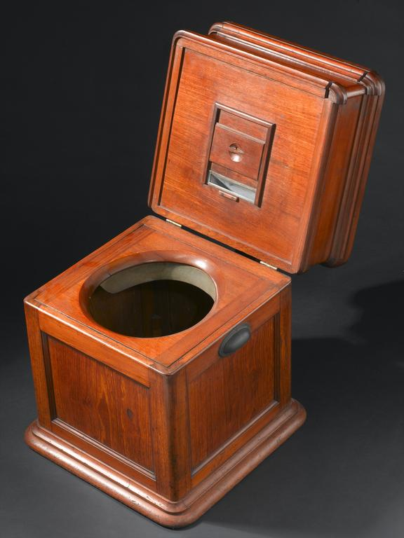 Table commode, mid to late 19th century. High three quarter view. Black background.