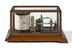 Barograph by Thomas Armstrong & Brother, photographed straight on view on a white background.