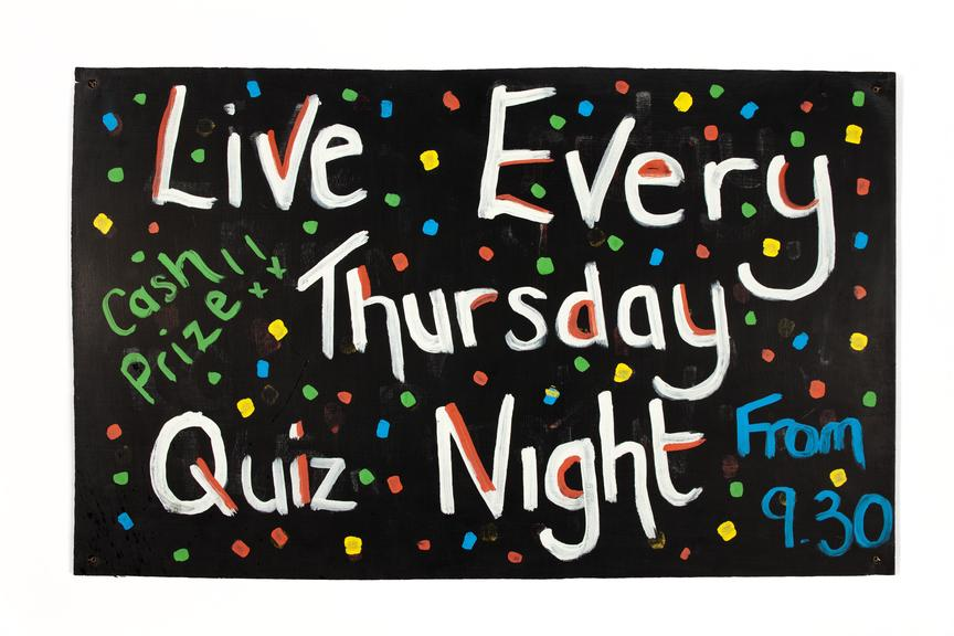 Quiz sign used in the making of shameless tv series..Straight on view on a white background.