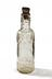 Tizer bottle photographed staight on on a white background