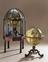 Terrestrial globe, on mahogany tripod stand with compass by G. Adams, in brass great circles; in octagonal glazed