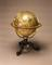 Celestial globe, on mahogany tripod stand with compass by G. Adams, in brass great circles, in octagonal glazed