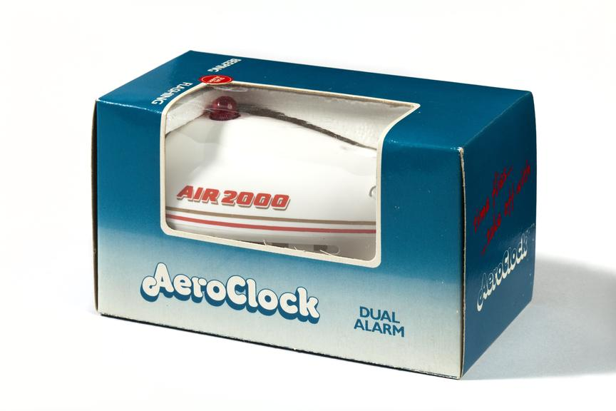 Boxed alarm clock in shape of aeroplane, sold on Air 2000 airliners as an inflight souvenir..Photographed 3/4 view on a