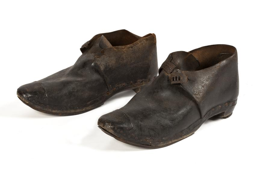 Miner's clogs, coal mining. C.1930.Photographed 3/4 view on a white background.