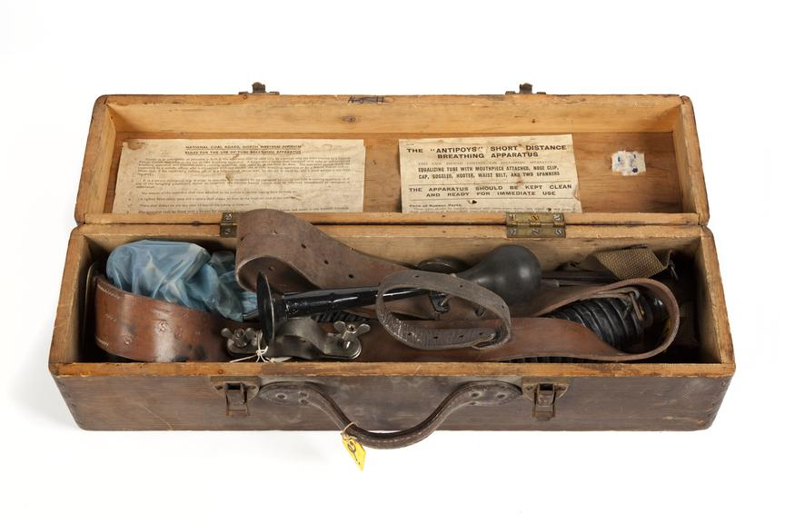 Breathing apparatus in a case, coal mining..Photographed from above on a white background.