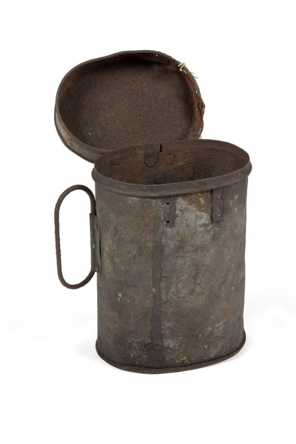 Powder Bag- Tin circular container. Manifacturer unknown. Part of Coal Mining Collection..Photographed 3/4 view on a
