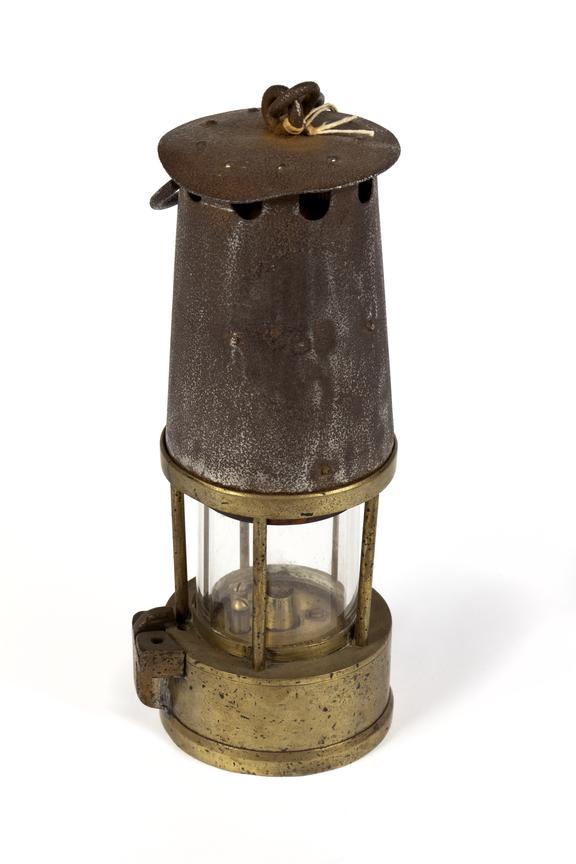 Oil safety lamp, coal mining. C.1920..Photographed straight on view on a white background.