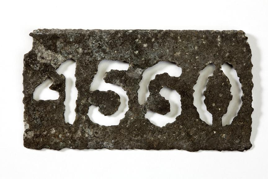 Gas lamp number plate '4560' Photographed straight on view on a white background.