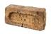 Brick engraved 'NCB AW'.Photographed 3/4 view on a white background.