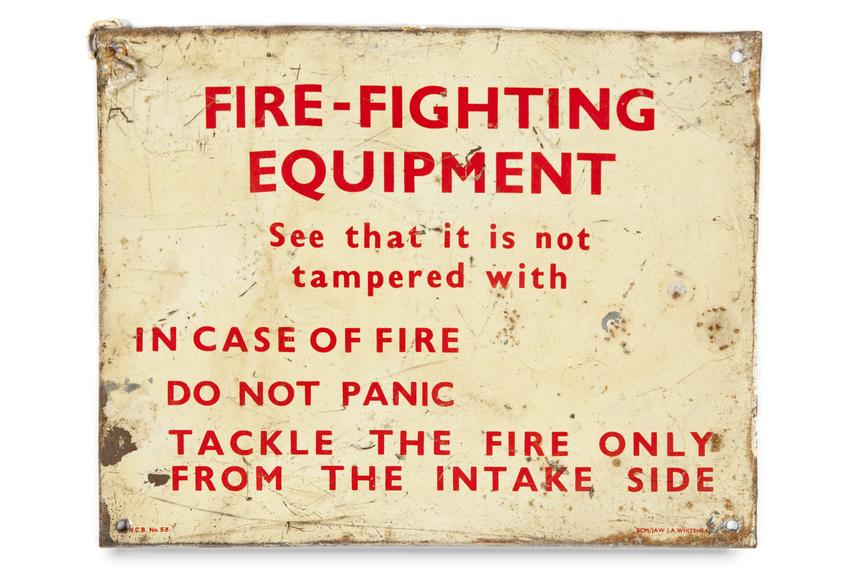 Sign - 'Fire fighting equipment...'.Photographed straight on view on a white background.