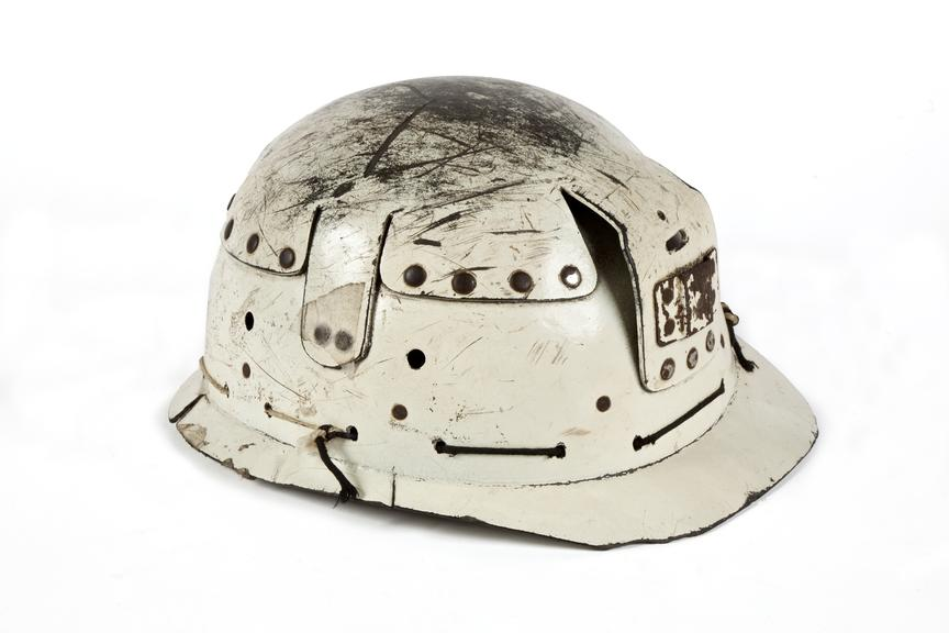 Fibrous miner's hard hat..Photographed 3/4 view on a white background.