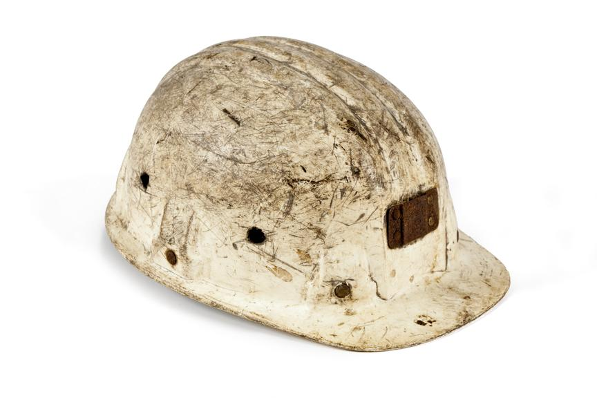 Plastic hard hat, coal mining..Photographed 3/4 view on a white background..