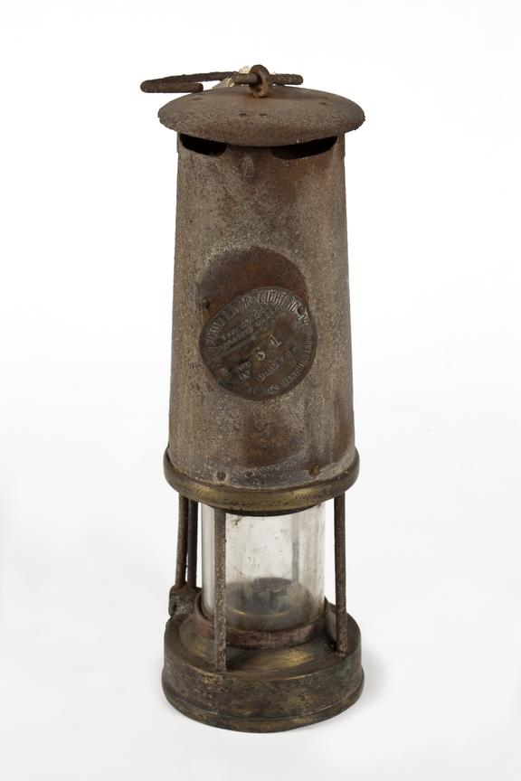 Pit-bottom miner's safety lamp made by Protector..Photographed straight on view on a white background.
