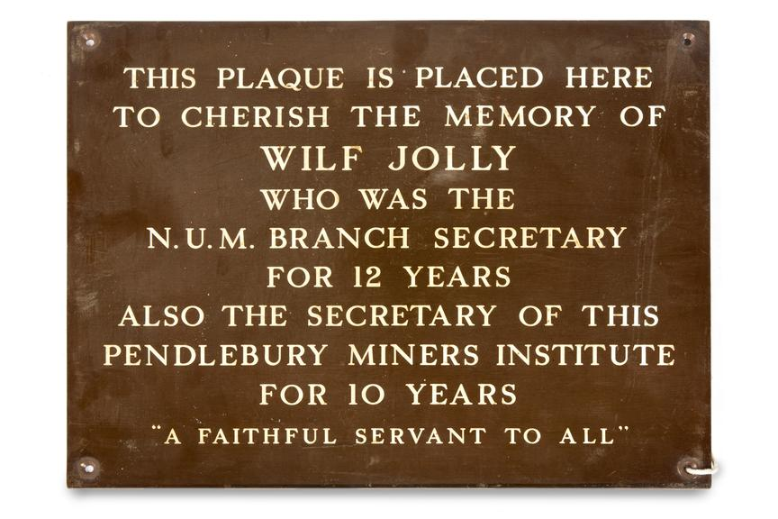Plaque, coal mining..Photographed straight on view on a white background.