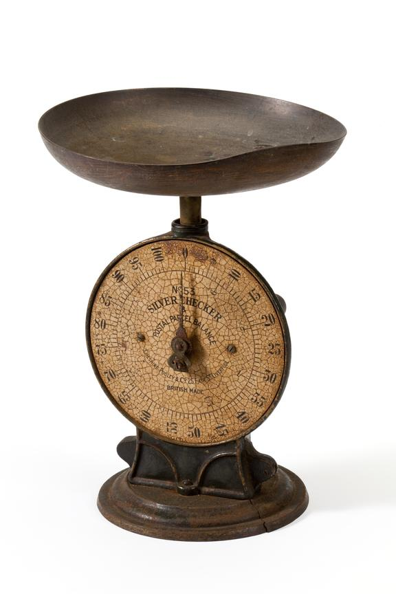 Postal scale, made by Cheshire Pooley, c.1900..Photographed 3/4 view on a white background.