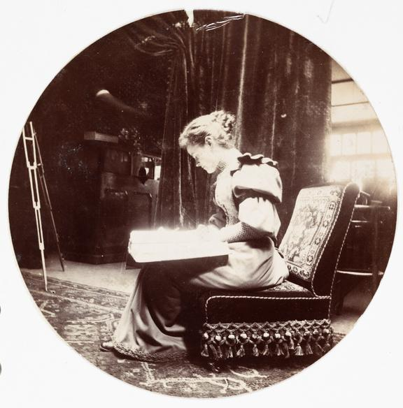 Woman reading, about 1890       A Kodak circular snapshot photograph of a young woman reading, taken by an unknown photographer in about 1890