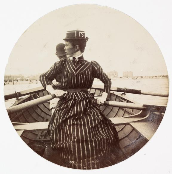 Woman in a rowing boat, about 1890       A Kodak circular snapshot photograph of a woman in a rowing boat, taken by an unknown photographer in about 1890