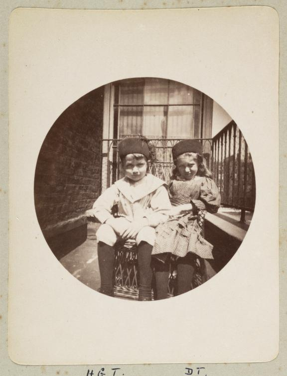 Two children on a balcony, 1888       A Kodak circular snapshot photograph of two young children on the balcony of 11 Montague Place, London