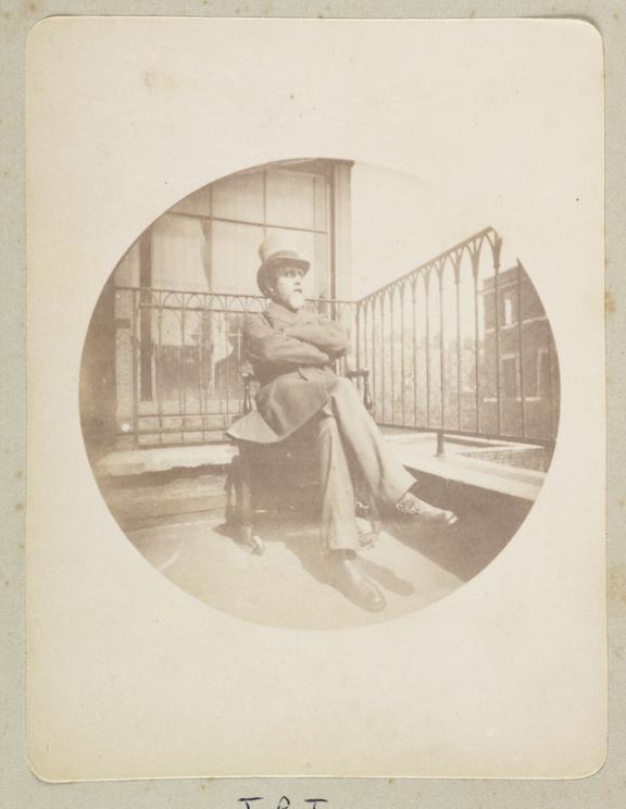 Man on a balcony, 1888       A Kodak circular snapshot photograph of a smartly dressed elderly man wearing a top hat