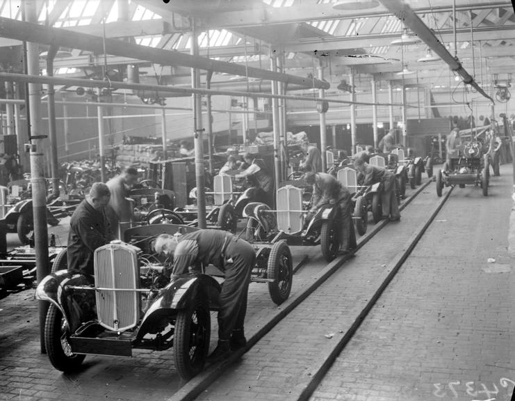 'The Manufacture of Triumph Cars at Triumph Works, Coventry'       A photograph of workers at the Triumph Works in Coventry, England