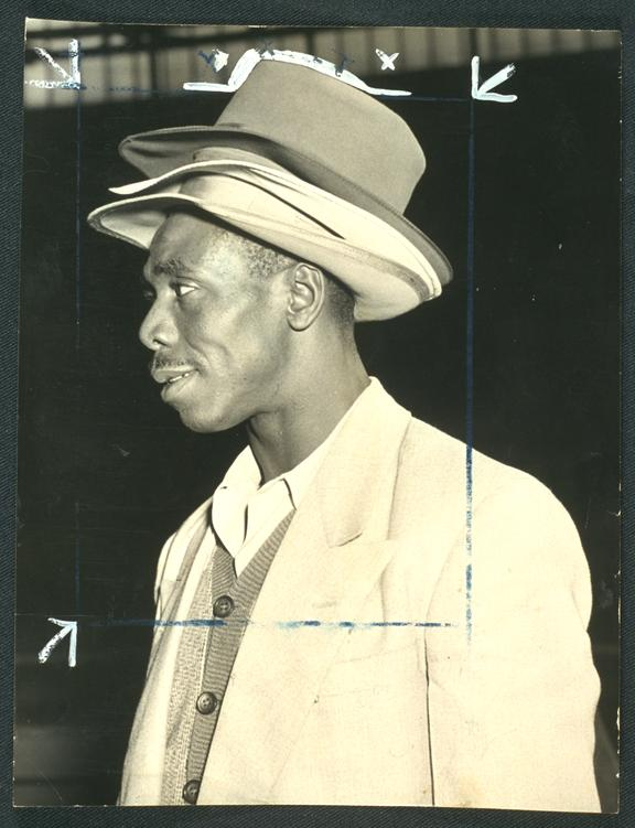 'Three trilby hats'       A photograph of Samuel White arriving in England from Jamaica