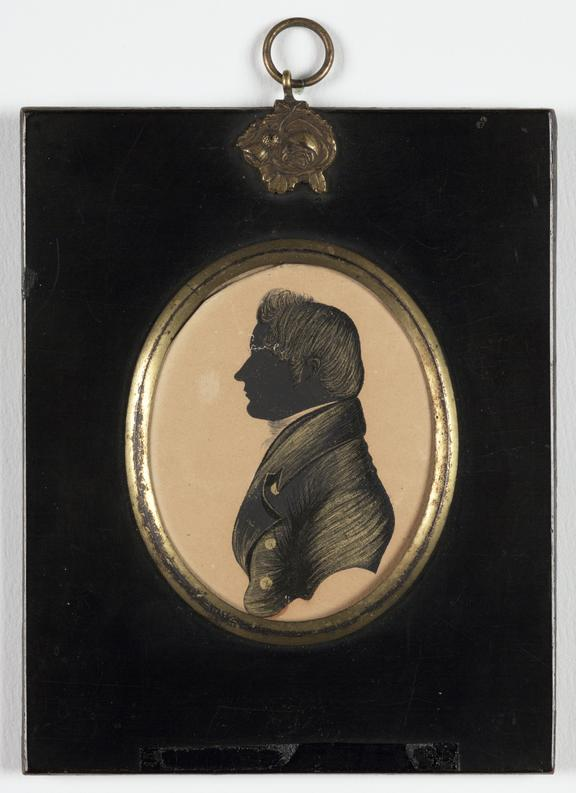 Silhouette of a man       A silhouette portrait of a man, set in a brass mount and wooden hanging frame