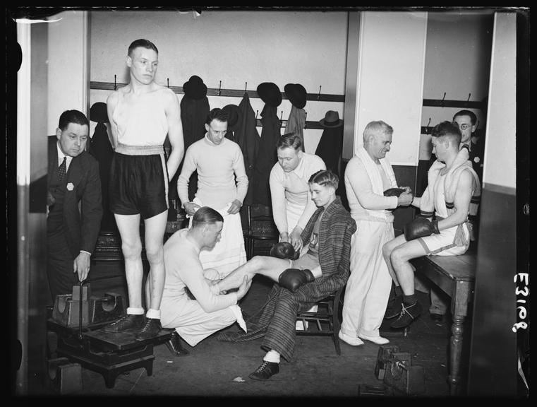 Amateur boxers prepare in the changing room       A photograph of men in the changing room in the Albert Hall, London, during the Amateur Boxing Association championship
