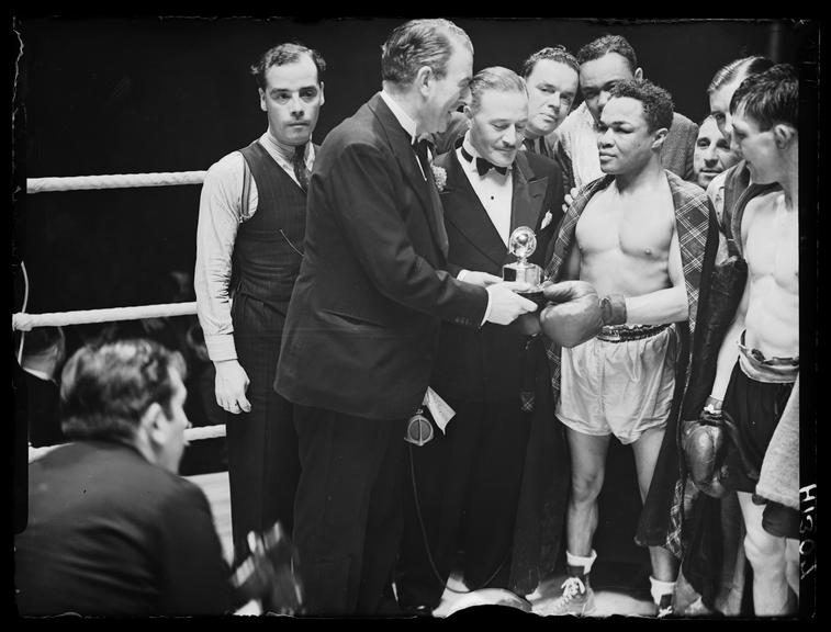 Henry Armstrong       A photograph of boxer Henry Armstrong (1912-1988) retaining the world welterweight championship