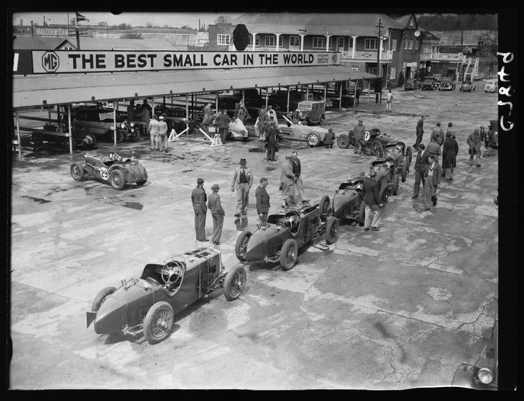 Racing cars at Brooklands       A photograph of racing cars at Brooklands circuit, Surrey