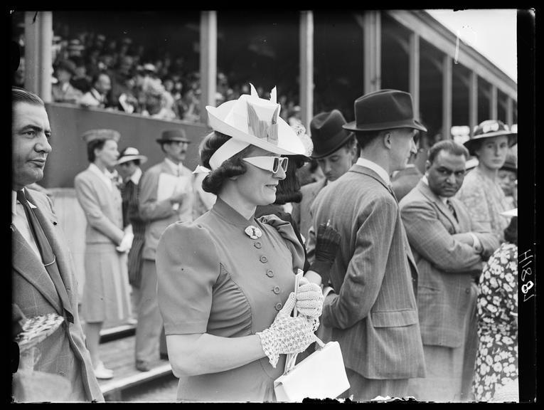 The Royal Richmond Horse show       A photograph of a woman watching the Royal Richmond Horse show