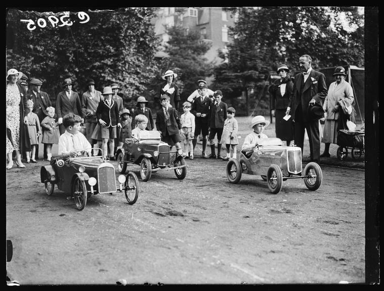 Pedal car race       A photograph of a pedal car race, taken by Edward Malindine for the Daily Herald newspaper on 21 June, 1933
