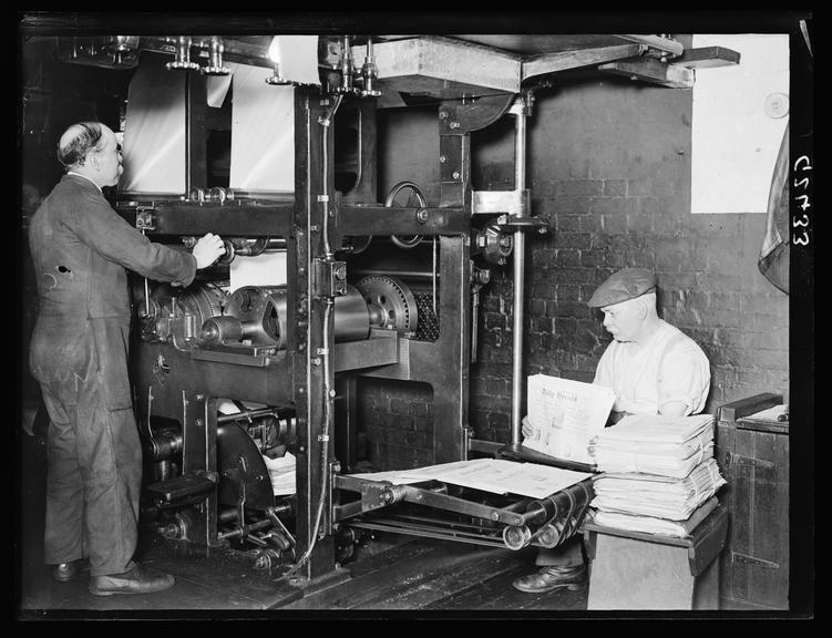 The Daily Herald machine room        A photograph of workers in the Daily Herald machine room