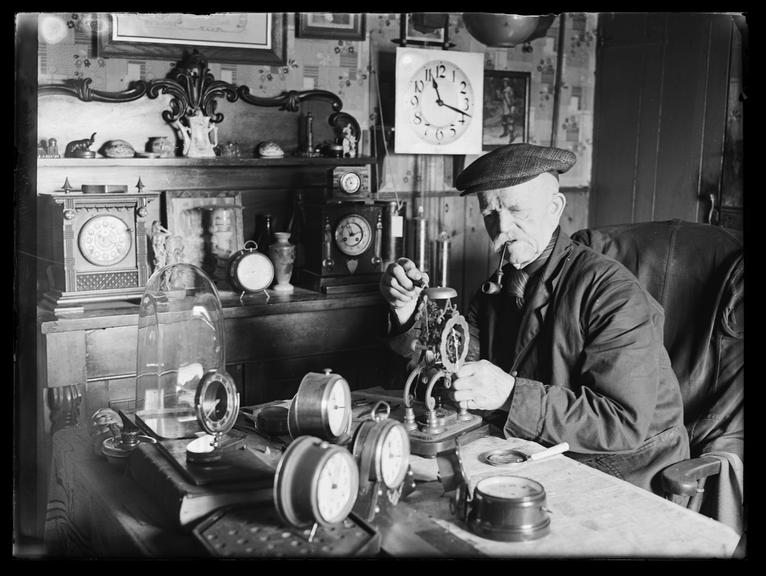 Clock repairer       A photograph of Charlie Rolfe, eighty-four year old clock repairer from Mannington, Essex