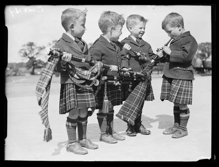Young bagpipers       A photograph of four young boys with bagpipes, taken by Woodbine for the Daily Herald newspaper on 17 June 1933