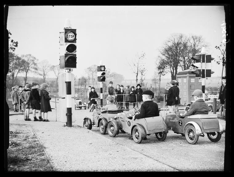 'Children's traffic playground'       A photograph of children driving toy pedal cars, taken by Saidman for the Daily Herald newspaper on 27 October, 1938