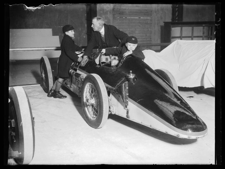 Schoolboy's Own exhibition       A photograph of two schoolboys admiring a racing car, taken by Malindine for the Daily Herald newspaper on 27 December