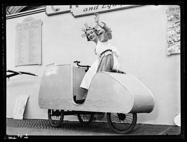 Ice cream tricycle       A photograph of a streamlined ice cream vendor's tricycle, taken by Tomlin for the Daily Herald newspaper on 29 January