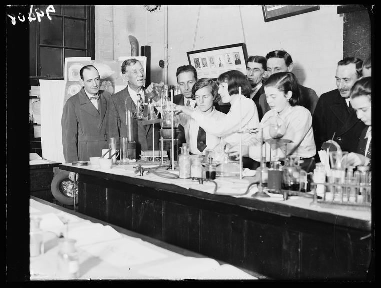 School chemistry demonstration       A photograph of a school chemistry demonstration in the laboratory of Balham Central School, London
