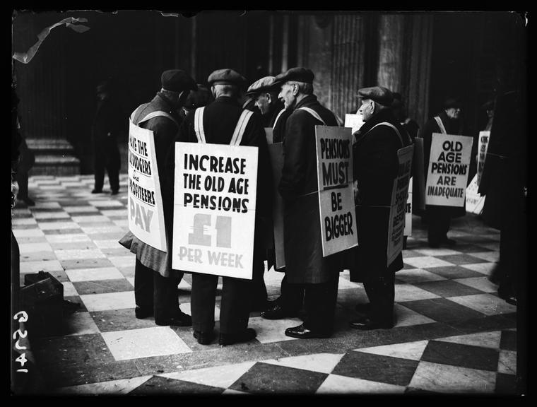 'Pensioners protest'       A photograph of a group of elderly men protesting for a higher pension